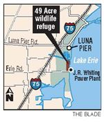 Utility-signs-over-upkeep-of-marsh-to-wildlife-agency