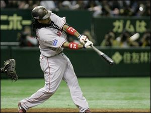 Boston Red Sox leftfielder Manny Ramirez his a two-run double off Oakland Athletics' Huston Street in the 10th inning of their Major League Baseball regular season opener at Tokyo Dome in Tokyo, Japan on Tuesday.