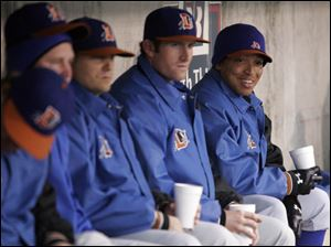 Durham relief pitcher Calvin Medlock, far right, chats with teammates during their game last night against the Mud Hens. Medlock is the only African-American player on the Bulls' roster.