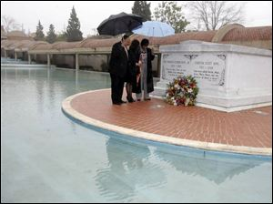 Martin Luther King III, left, his wife, Arndrea, and sister, the Rev. Bernice King, pray at Martin Luther King, Jr.'s tomb.