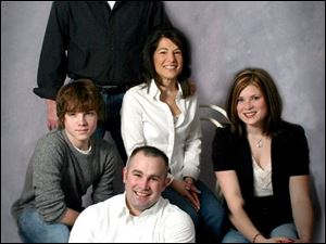 The Donahue family portrait: Background, the father, Dennis, now deceased; mother, Karen, center, and from left, children Blake, Brandon, and Taryn.