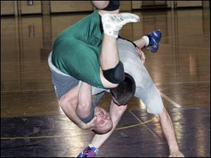 Adam Murray throws Matt Marek to the mat during a practice.