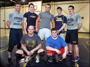 The University of Toledo Wrestling Club's members are, back row, from left, coach Matthew Rempe, Luke Nye, Drew Metzger, Tom Kiefer, and Adam Murray, and front row, from left, Matt Marek and Jeff Piotrowski.