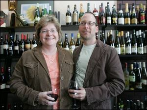 Kimberly and Doug Reinhart in Calvino s wine shop, one of the stops for the UT progressive dinner.