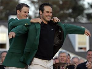 Zach Johnson puts the green jacket on Trevor Immelman of South Africa after Immelman won the 2008 Masters golf tournament at the Augusta National Golf Club on Sunday.