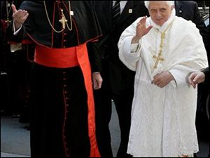 Pope Benedict XVI, right, is escorted by Cardinal Edward Egan, archbishop of New York, left, as he arrives at St. Patrick's Cathedral in New York, Saturday, April 19, 2008.