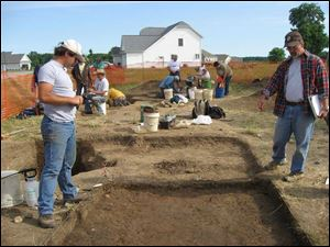 Brian Redmond, right, directs the excavation of a test unit. They have been able to follow the evolution of a transient fishing village into a stable farming community.
