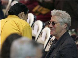 Actor Richard Gere attended and paid close attention to His Holiness the Dalai Lama's first session in Crisler Arena.