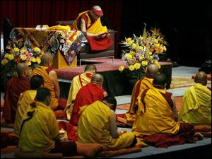 About 25 monks sat on the stage with the Dalai Lama.