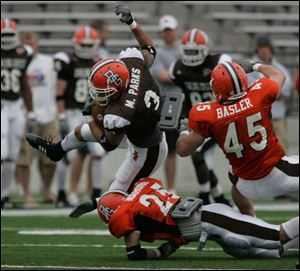 Marques Parks gets brought down by P.J. Mahone after grabbing a pass at Doyt Perry Stadium.