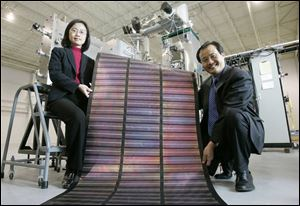 Xunlight founders Liwei Xu, left, and her husband, Xunming Deng, a professor at the University of Toledo, plan to expand the company s facility to make flexible solar panels.