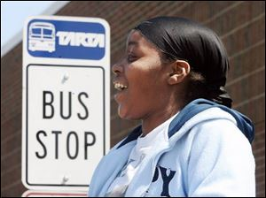 LaQuanda Brown waits for the bus that will take her to downtown Toledo from the Owens Community College campus.