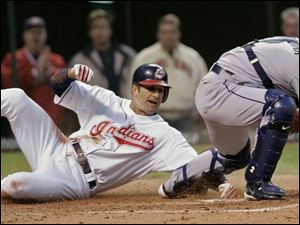 The Indians' Casey Blake tries unsuccessfully to avoid a tag by Mariners catcher Kenji Johjima.