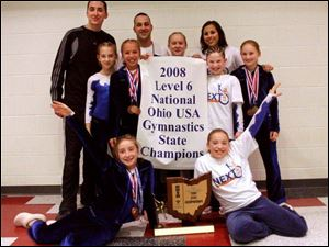 The 2008 Level 6 Gynastics team: Front, Emily McLargin and Emily Woodruff. Standing, coach Dustin Costanzo, Ashley O'Neal, Erin Gyurke, coach Nick Distel, Elizabeth Mosher, coach Alesha Martinez, Samantha Sperlik, and Erica Schlets.
