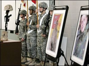 The 983rd Engineer Battalion color guard stands in the Army Reserve unit s headquarters by portraits of