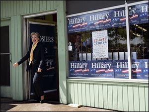 Democratic presidential hopeful, Sen. Hillary Rodham Clinton, D-N.Y., emerges from her campaign headquarters in South Bend, Ind., on Sunday to speak to campaign canvassers.