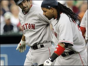 Manny Ramirez, right, scored on Mike Lowell's home run.