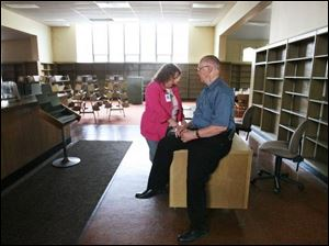 Edward Slack, right, public relations chairman with the Toledo History Museum Inc., and Jeanette Morrell, a real estate specialist in Toledo, discuss the future of the old Locke Branch Library.