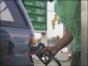 Rick Willis pumps $20 worth of gas into his Ford Explorer at