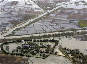 An aerial view of devastation caused by the cyclone Nargis on Saturday, is seen at an unknown location in Myanmar on Tuesday. Myanmar's Irrawaddy delta, where nearly 22,000 people perished, remained largely cut off from the rest of the world Tuesday, four days after a cyclone unleashed winds, floods and high tidal waves on the densely populated region. (ASSOCIATED PRESS)