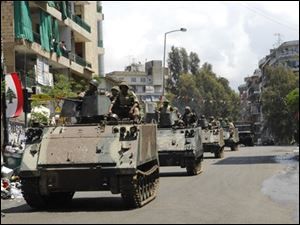 Lebanese soldiers patrol the streets during clashes in Beirut, Lebanon, Friday, May 9, 2008. Shiite Hezbollah gunmen seized nearly all of the Lebanese capital's Muslim sector from Sunni foes loyal to the U.S.-backed government on Friday following the country's worst sectarian clashes since the bloody 15-year civil war.