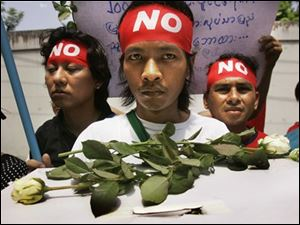 Demonstrators carry a mock ballot box during an anti Myanmar government rally.