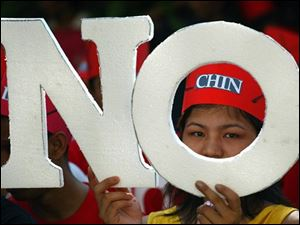 "A Myanmar protester holds placard reading ""NO"" during a demonstration outside the Myanmar Embassy in Kuala Lumpur, Malaysia, Saturday, May 10, 2008. Some 500 activists demonstrated Saturday at the Myanmar Embassy in Malaysia, demanding that Yangon call off its constitutional referendum even as voting began in the military-ruled nation despite a devastating cyclone."