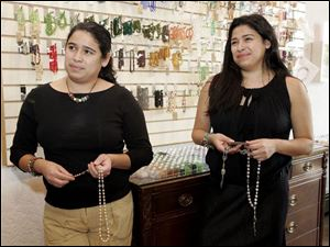 Twin sisters Anita Tristan, left, and Ann Tristan feature religious beads at their Bonita Bead Boutique in Maumee.