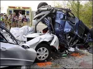 Rescue crews survey the scene of a crash in West Springfield,