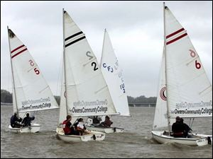 A team of three boats from Ohio State University competes in the Owens Team Race Invitational. Eight teams attended the event, held yesterday on the Ottawa River near the Jolly Roger Sailing Club. Inclement weather forced the event to drop the number of heats from 28 to 18.