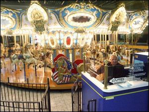 Paul Misch operates the mall's carousel. Few people ride the carousel these days, he said.
