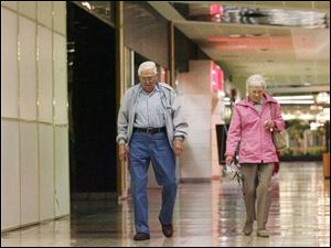 Carl and Ruth Jenne, right, said they would miss the mall for walking more than shopping.