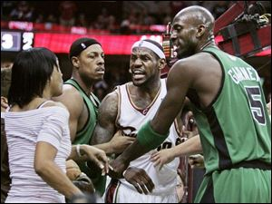 LeBron James yells at his mother, Gloria, to sit down after he