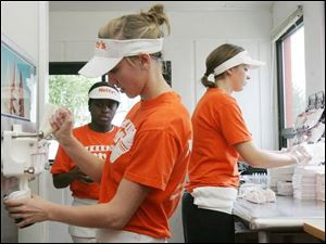 From left, Asia Evans, Alexa Sanders, and Tanya Hufford got jobs at Netty's on Monroe Street, where hiring has been cut.