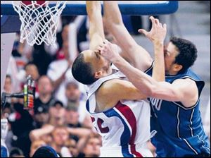The Pistons' Tayshaun Prince makes a key block of a dunk attempt by the Magic's Hedo