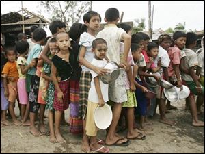 Myanmar children line up to receive free rice after the destructive Cyclone Nargis on the outskirts of Yangon, Myanmar, Monday. (ASSOCIATED PRESS)