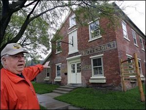 Tom Wagener and his late brother, Al, began restoring the Maumee Color Co. building, also known as the Buttergilt Building, in the late 1970s. They were among those honored last night by the Landmarks Preservation Council of Northwest Ohio at the Park Lane Apartments in Toledo. (BLADE PHOTOS/DAVE ZAPOTOSKY)
