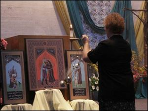 Sister Diana Lynn Eckel uses incense in blessing an icon, a triptych depicting St. Francis of Assisi's 1219 visit to Egypt, in an installation ceremony at the Sisters of St. Francis chapel.