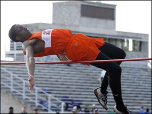 Southview Junior Shaun Joplin clears 6-9 to set a Northern Lakes League high jump record.
