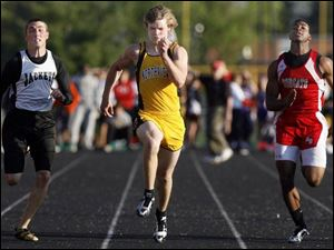 Josh Boileau beats the Jackets' Ian DeWalt and the Bobcats' Taylor Southall in the 100 meters.