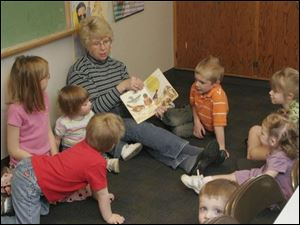 Lola Nelson reads to children in a recent 'Story Time with Lola' session at Zoar Lutheran Church in Perrysburg.