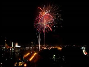 As seen from the Anthony Wayne Bridge, fireworks explode over the Maumee River to mark the Fourth of July.