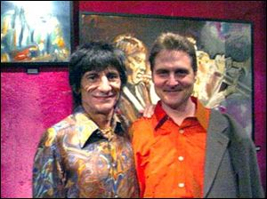 Rolling Stones guitarist Ron Wood, left, with Tim Ries at a showing of Wood's art.