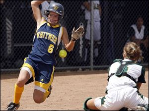 Whitmer's Brooke Zaleski scores as the ball gets by Clay