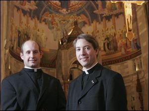 Deacons John Miller, left, and Eric Culler in Rosary Cathedral, where they will be ordained as priests today by Bishop Leonard Blair.