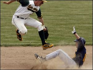 Joseph Dorocak of Cleveland St. Ignatius steals second base in the fifth inning as Start's Aaron Newman goes airborne.