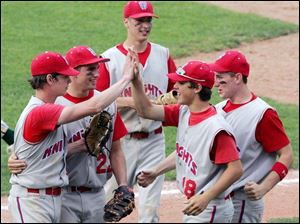 St. Francis pitcher Alex Radon, left, is congratulated by his teammates after he picked up the victory over Clay last night.