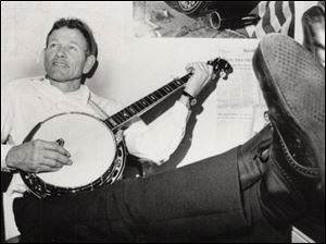 Gene Damschroder displays his banjo skills in 1976, during his stint as an Ohio legislator. He was also a square-dance caller.