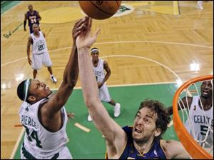 Boston Celtics' Paul Pierce (34) and Los Angeles Lakers' Pau Gasol, from Spain, battle for a rebound in the second half of Game 2 of the NBA basketball finals Sunday in Boston.