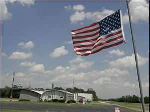 The flag flies at half staff outside Fremont Airport yesterday in memory of Gene Damschroder and his five passengers. Yesterday there was speculation the pilot knew he was going to crash and tried to land in the only clearing available nearby.